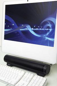 Audio Bar with Mac angled close-up